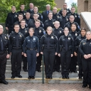 "The graduates from the Appalachian Police Academy — part of Appalachian State University's new Appalachian Police Development Program (APDP). Graduates are: Elijah Baker, Chase Bowman, Thomas-Ross Cloer, Madison Cook, Brendan Counts, Michael Dunmire, Patrick Fee, Cintya Garcia, John ""Jack"" Greene, Bryce Helms, Austin Joyce, Brandon Kelsey, Sam Mueck, Lena Nguyen, Ferrin Page, Clayton Robert, Ryan Ruff, Joseph Scott, Trevor Smith, Samuel Upton and Joshua Warren. Also pictured: Chief Andy Stephenson, Lt. K.C."