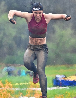 Carmen Lowe '15 '16, a native of Salisbury, participates in the Charlotte Spartan Sprint, an obstacle course race. As a special agent trainee at the NC Alcohol Law Enforcement (ALE) agency, Lowe said that maintaining her fitness is an important part of the job. Lowe got involved in obstacle course racing through the encouragement of her professor, Dr. Tammatha Clodfelter. Photo submitted